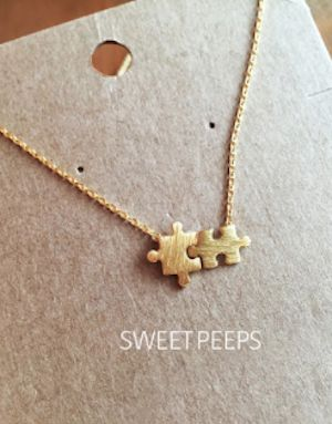 tiny gold plated puzzle piece necklace