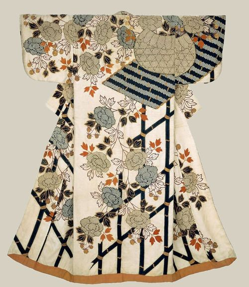 """osode (proto-kimono), early 18th century, Japan. """"Robe (kosode) of white silk damask (rinzu) with overall ground pattern of interlocking swastika (manju tsunagi) and a surface design of a basket and peonies covering a bamboo fence in blue, brown, reddish-orange, purple and gold created by stenciled imitation tie-dye (kata kanoko), hand-applied indigo (ai-zuri) and embroidered with silk and couched with metallic gold-covered thread.     MFA. (William Sturgis Bigelow Collection)"""