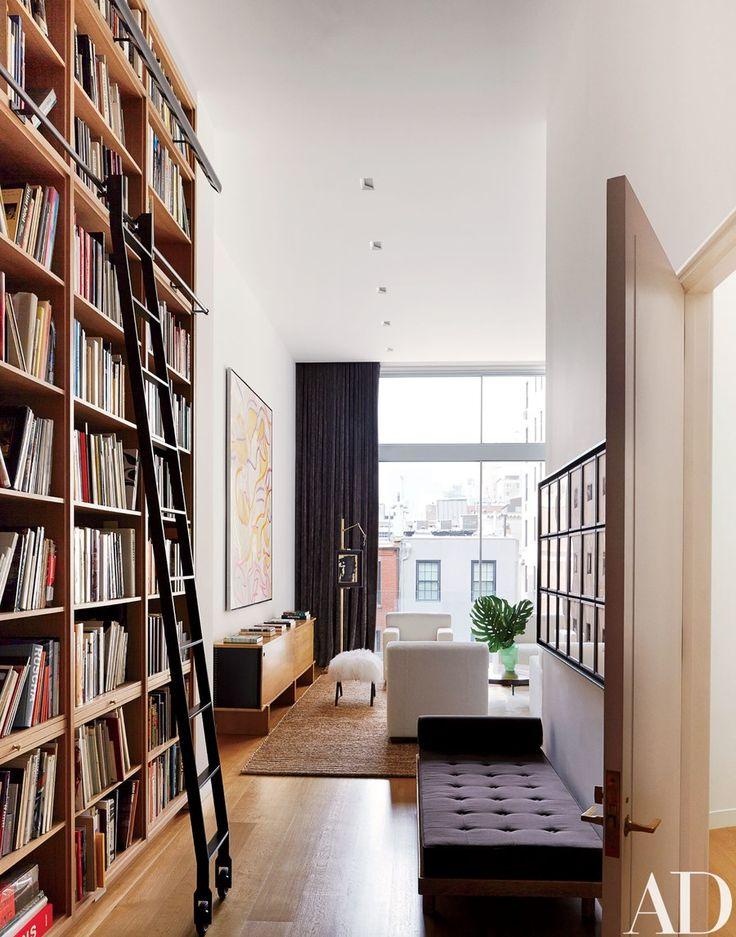Floor-to-ceiling oak bookshelves distinguish the library.