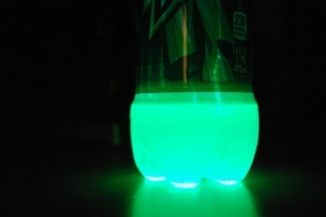 Mountain Dew glows by adding peroxide and baking soda to it. Gross, but the kids are going to love this.@ Leslie Gill, my chemistry maven, will this work?