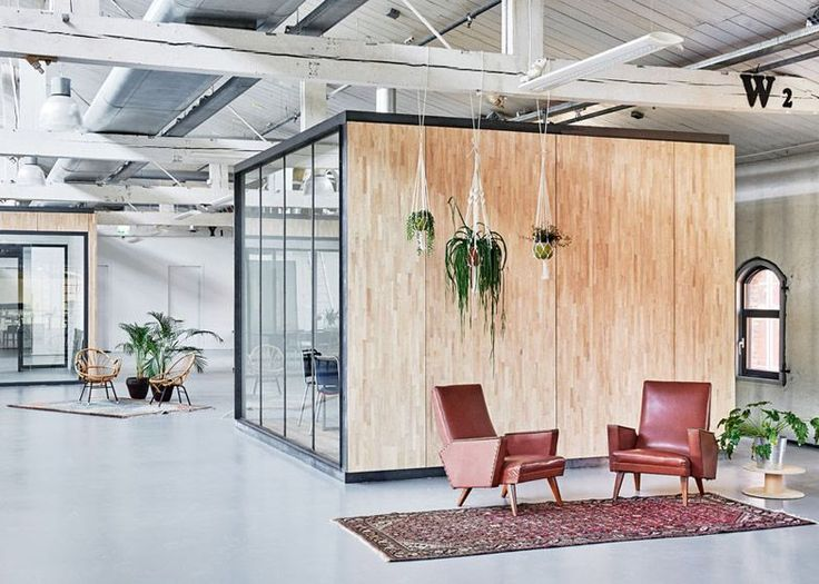 Fairphone's Amsterdam offices built inside an old warehouse using reclaimed materials.