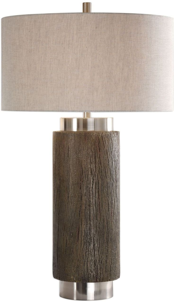 This Lamp Mixes A Contemporary Feel With Stacked Cylinder Shapes And A Strong Rustic Design With The Faux Wood Base, Finished In An Old Driftwood Stain, Accented With A Rottenstone Glaze And Brushed Nickel Plated Details. The Round Hardback Drum Shade Is A Khaki Linen Fabric With Natural Slubbing.