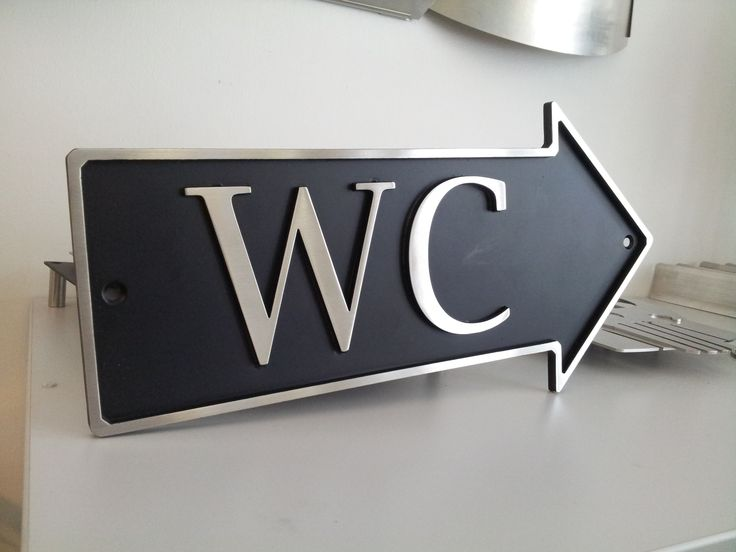 Stainless toilet sign.