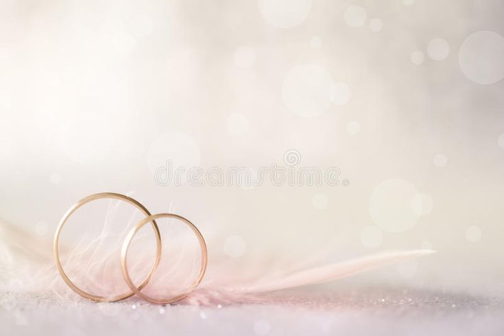 Two Golden Wedding Rings And Feather Light Soft Background For Marriage Ad Wedding Ring Background Wedding Background Images Wedding Background Wallpaper