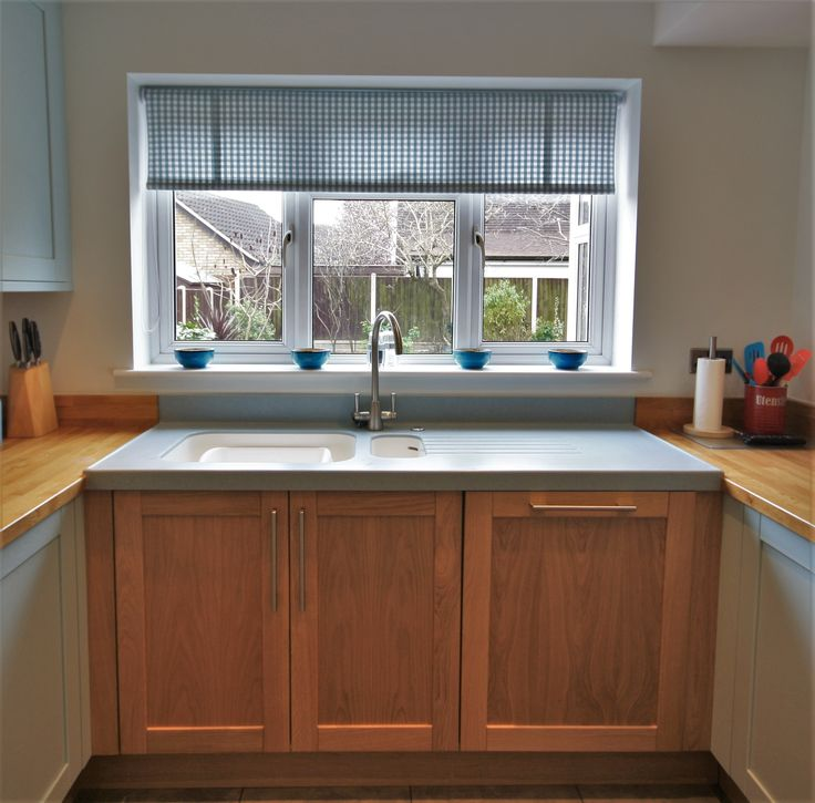 Corian worktop around the sink area, to protect the solid Oak worktop from water damage, the sink is also a Corian sink to create the seamless effect.