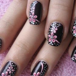 Pretty nail art.   Black with pink flowers on top♥
