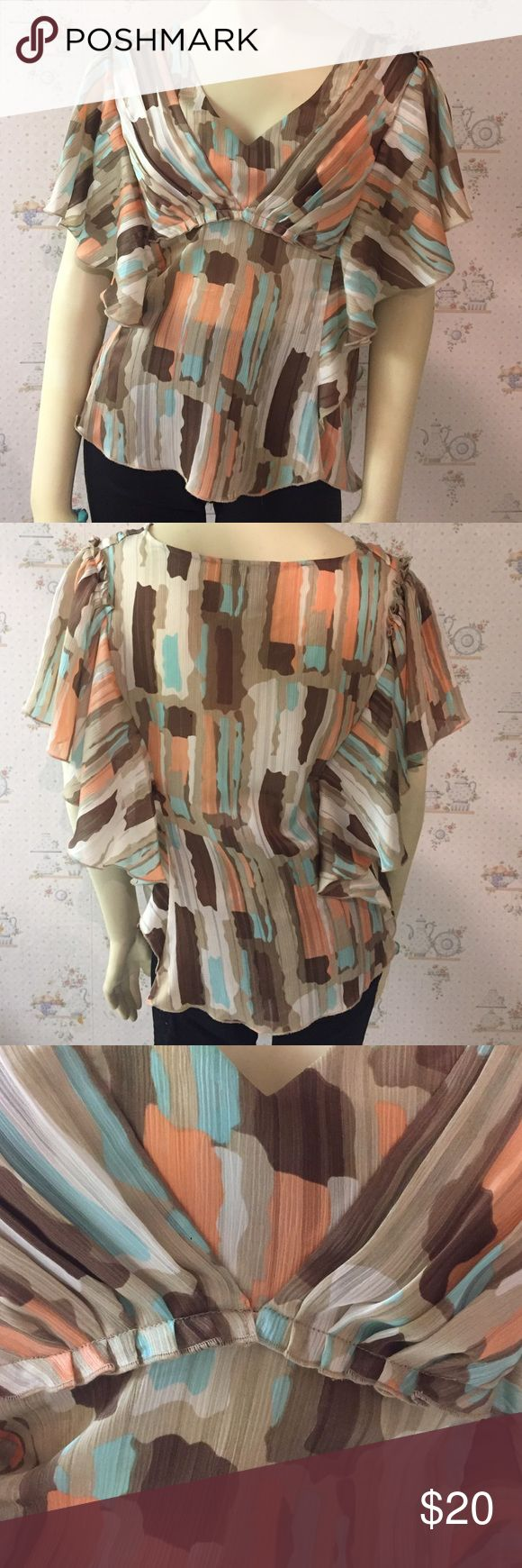 Multicolor BCBG Generation Short Sleeve Blouse This top is so figure flattering and sexy. Excellent pre owned condition. 100% Polyester. Side Zipper. Sheer but colors blend in with skin. Always wore a tan or nude bra underneath. Pair with skirt or skinnies. Bundle for additional discounts. No trades. BCBGeneration Tops Blouses