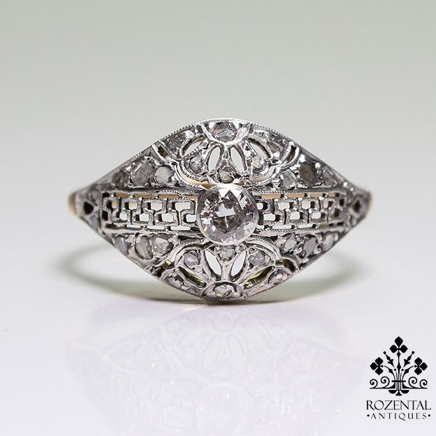 Period: Art deco (1920-1935) Composition: 18 K Gold & Platinum. Stones: - 1 Old mine cut diamond of H-VS2 quality that weighs 0.20ctw. - 28 Rose cut diamonds of J-SI3 quality that weigh 0.35ctw. Ring
