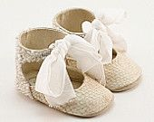 Baby shoes from crystal-embellished beige fish leather