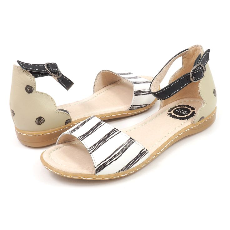 Hand-drawn stripes and an elegant narrow strap and silver buckle make Georgie both a youthful and sophisticated sandal. This big girls sandal sporting refined details, like the scalloped heel an slimmer silhouette, is pure Livie & Luca style.