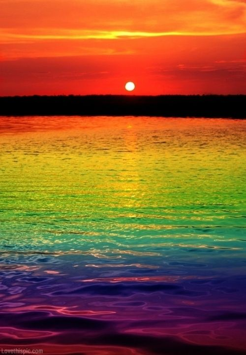 rainbow sunset colorful sky sunset ocean water sun rainbow