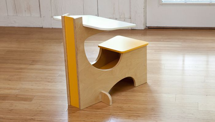 Cool School Desk This bright little desk offers the perfect perch for the budding toddler scholar. School bus-yellow paint is an eye-catching accent.