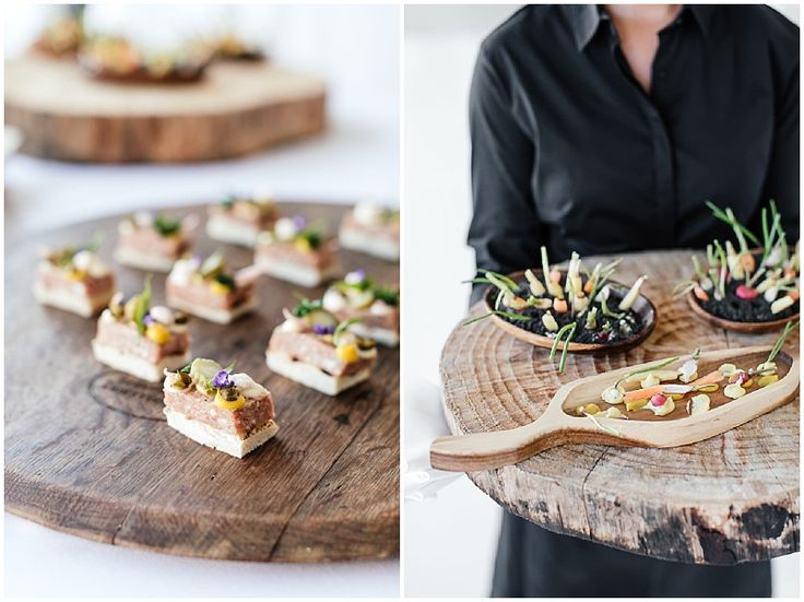 Elegantly plated canapes, served on rustic wooden boards.