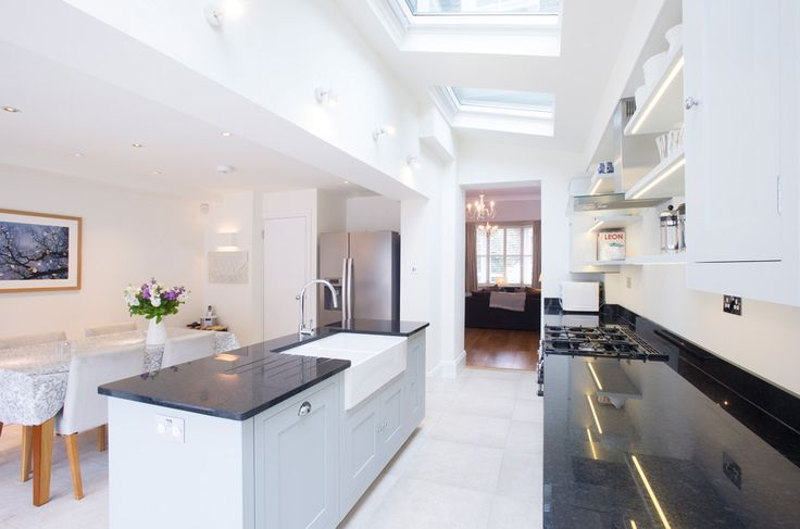 Side Return Extension and Loft Conversion on a Victorian Terraced House in Camden, NW5, Greater London, Bi-fold doors, Velux Roof Lights, Pitched roof, Patio Section, Level Threshold, Kitchen Extension Ideas, Rear Extension, Contemporary Kitchen, Open-plan kitchen dining and living, open plan layout ideas, Pumice Ivory Floor tiles, Skylights in Kitchen