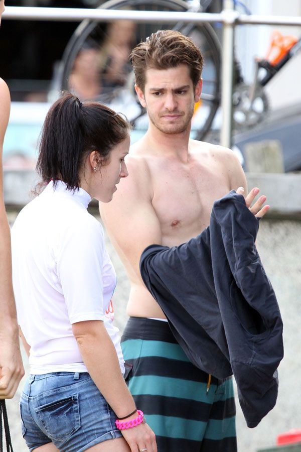 Andrew (Hot) Garfield removes his shirt on Australia's Bondi Beach during the Surfing for Autism charity event.