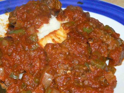 Homemade Old Fashioned Swiss Steak.  Stick to your ribs old-fashioned comfort food. Fork tender steak with a tomato based gravy and a mountain of mashed potatoes.  It doesn't get any better than this.