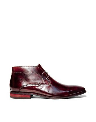 Let your sharp sense of style speak for itself with men's dress and casual  boots by Steve Madden.