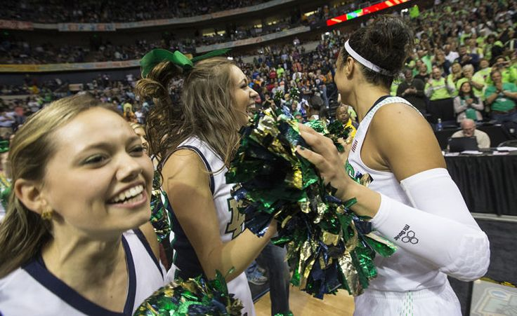 Notre Dame's Kayla McBride, right, celebrates with cheerleaders as she exits the court following the 87-61 victory over Maryland in the NCAA Women's Final Four basketball game on Sunday, April 6, 2014, inside Bridgestone Arena in Nashville, Tenn. SBT Photo/ROBERT FRANKLIN