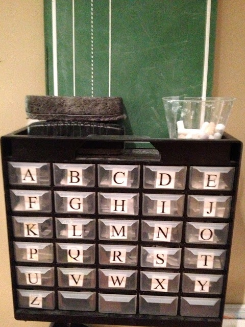 Little drawers of letters in the writing area. To store the mini erasers and figures for letters?!?!