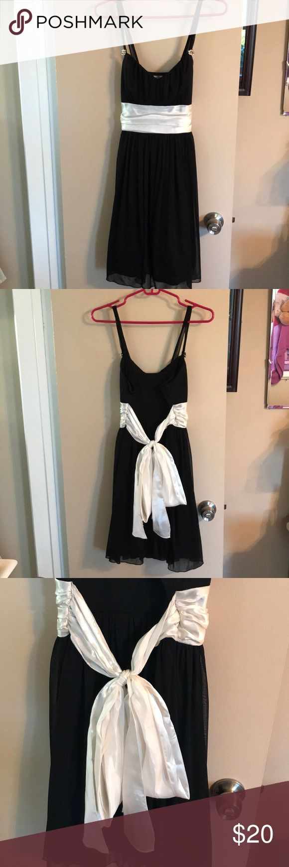 "Trixxi Formal Dress from Macy's Junior Section It is an adorable homecoming-type dress. It is black with a white sash that ties around in the back. It has a sort of heart shaped neck line with jewel detailing on the straps. Very flattering on all body types because it sinches in at the waist and is short, but long enough for tall girls. I am 5'8"" and it went up to my knees in length. Very comfortable and breathable. Perfect for a prom, homecoming, dance, or any cocktail party type setting…"