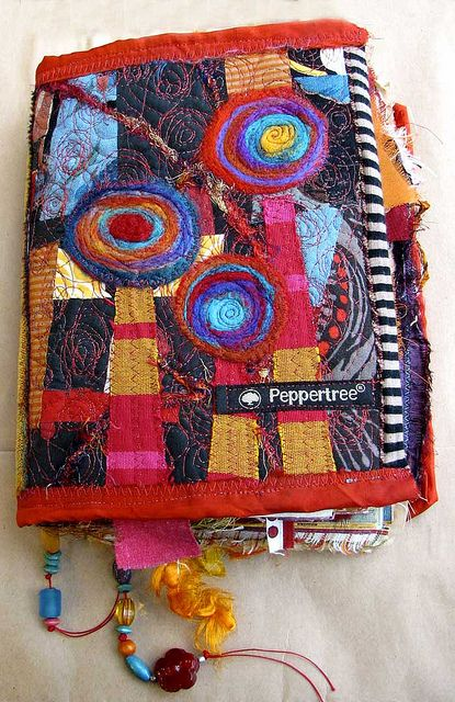Ro Bruhn - stitched and felted cover by ro_bruhn, via Flickr...love the textures and colors...=}