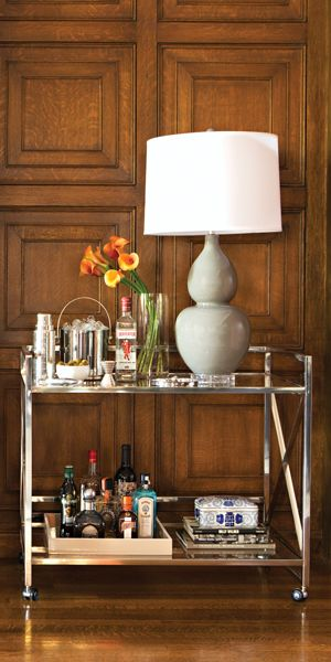 The stainless steel and glass X Frame Bar Cart is easy to maneuver from room to room. Shop online now. #LivingSpaces