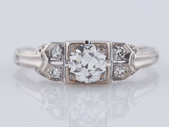 I love this https://www.etsy.com/listing/230259160/1930s-engagement-ring-art-deco-55ct-old