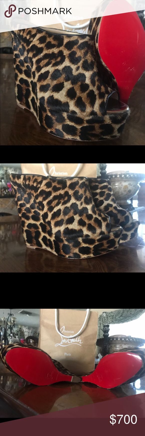 100% Authentic Christian Louboutin Leopard wedge Excellent Condition Never Worn Leopard Wedges. I do not have the box. Size 40 1/2 (But fits for a 9.5 foot) Christian Louboutin Shoes Wedges