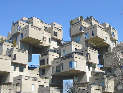 Habitat 67 is a 148 unit housing complex made up of 354 cubes. It was erected for 1967's World Fair held in Montréal. The complex was designed to provide single family housing with privacy that most city apartment buildings lack. I was there!!!