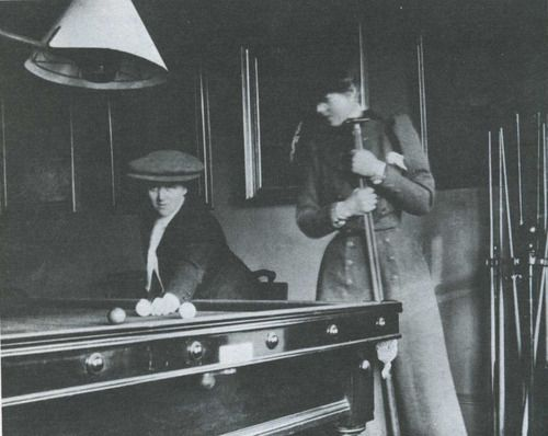 Queenie and Gertrude playing billiards, ca 1903
