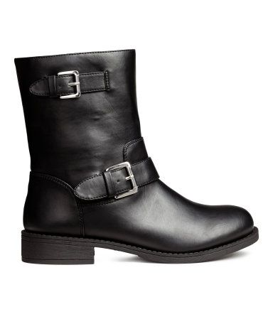 Black. Biker boots in imitation leather. Adjustable straps with metal buckles…