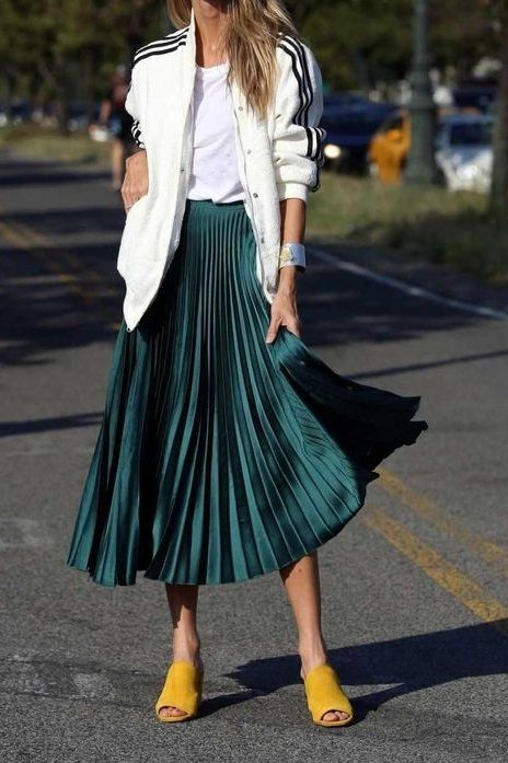 03a37d675b A pleated skirt paired with a casual cardigan and a white tee screams sporty,  yet feminine... and we're totally here for it!