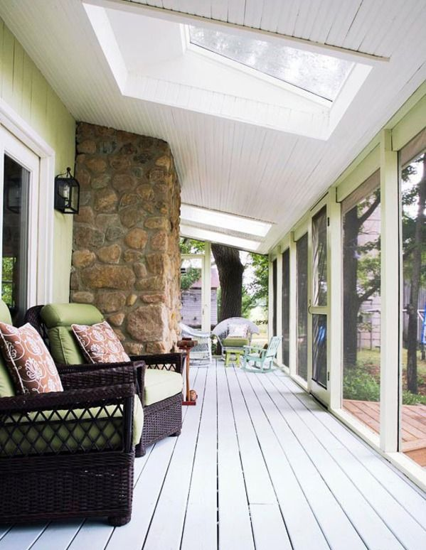 This is such a well-designed porch. I like the refined wicker furniture and small area of stone. It's outdoorsy without being overtly rustic, so it could flow...