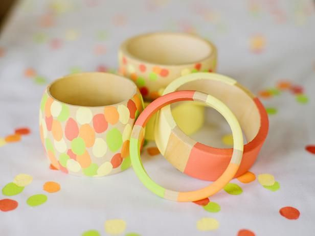 From fingerprints to polka dots and stripes, these easy painted wooden bracelets are easy enough for kids to make but stylish enough for Mom to sport.
