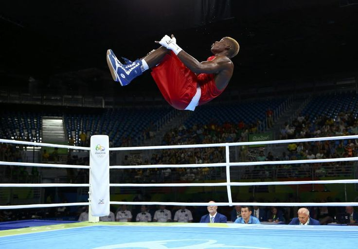 Day 4 - Olympics 2016 Dieudonne Wilfred Seyi Ntsengue of Cameroon celebrates after winning his bout in men's middle 75kg boxing. REUTERS/Peter Cziborra