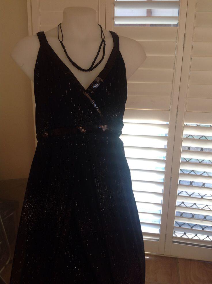 Black/silver long formal dress with sequin detail. Nikki Mae .  www.alongthebridalpath.com.au