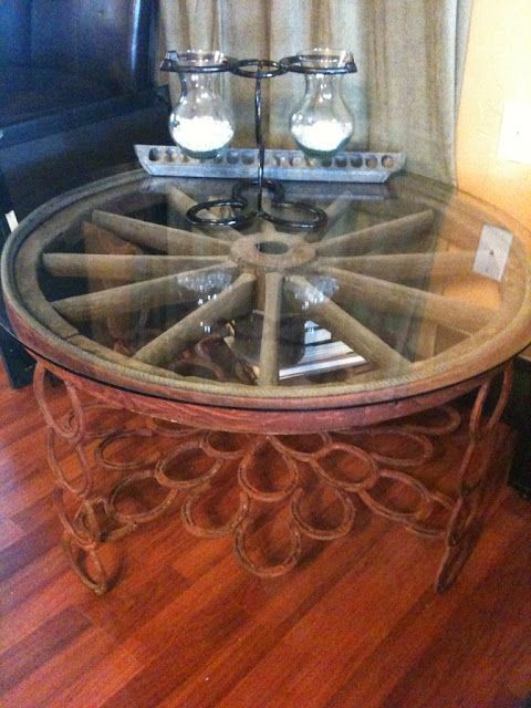 The wagon wheel table made from horse shoes