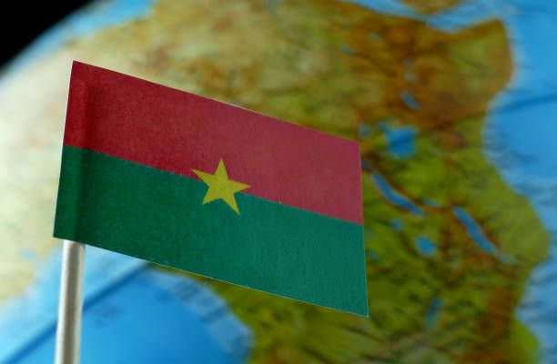 burkina faso flag with a globe map as a background