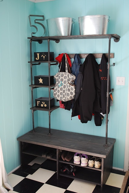 DIY Pipe and Flange shelving unit  courtesy of the Junky Vagabond blog spot.  Love this shelving unit and coat rack.  Great job Jill!