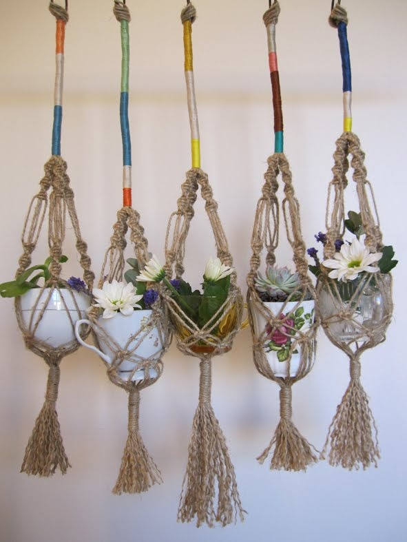 Macrame plant hangers. A blast from my past. We used to make these. It isn't that difficult. One of the things I hated to see go from the late 1970's. Love how they wrapped the tops in color!
