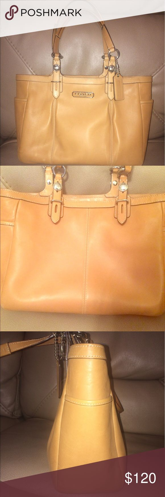 Coach leather handbag Authentic coach leather handbag in tan. In good condition. All it has is a lighter streak. See last picture. Not really noticeable. Nothing a leather conditioner couldn't help. Comes with its coach tag and still has the cleaning instructions inside. Coach Bags Shoulder Bags