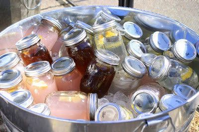 Want to make things a little more simple for your guests? Try mixing up cocktails in advance and storing them in Mason or canning jars. They can easily be tossed into a cooler or tub with ice to keep cold and there's no muss or fuss and worry of measuring specialty drinks when you're busy with other party maintenance.
