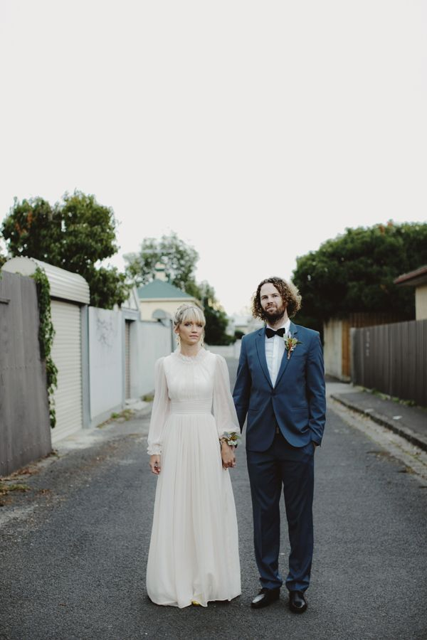 Bespoke 70's inspired wedding dress with billowing sleeves and ruffled neck. Beautiful.