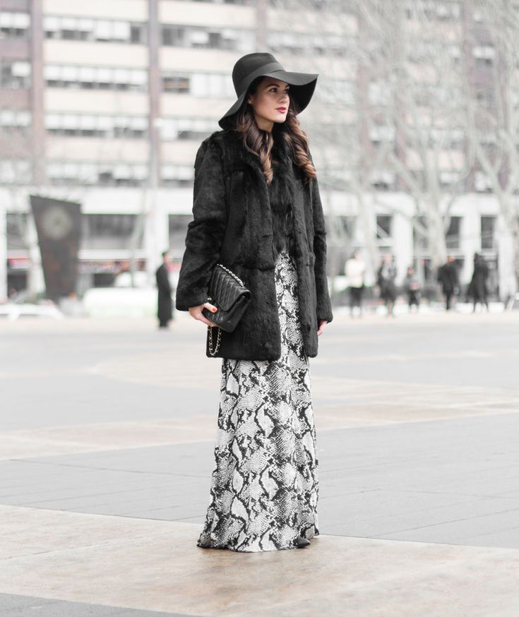 Black and White Outfit Ideas: Sarah Butler is wearing a Missguided snake print maxi dress with a black Elizabeth and James fur coat