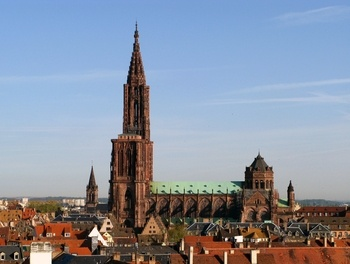 Strasbourg, France - Boasts an amazing gothic cathedral.  When I visited with my Girl Scout Troop back in the late 80's, the cathedral was still undergoing repairs for the damage done to it during a WWII air raid.