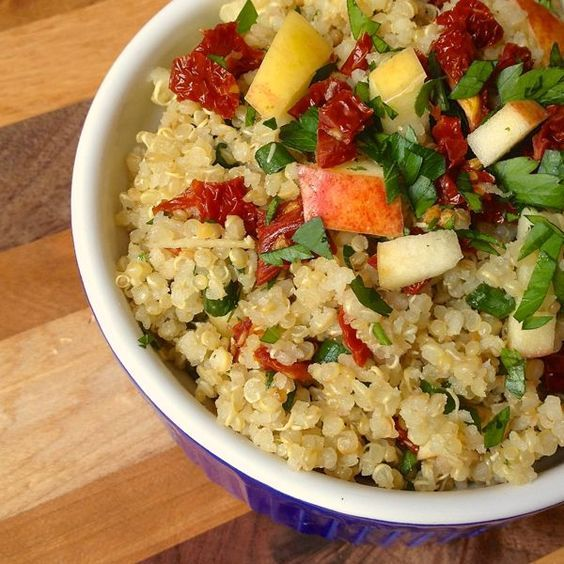 Quinoa with Sun-Dried Tomatoes, Apples and Scallions - Quinoa is tossed with sun-dried tomatoes, apples and scallions in a garlicky lemon vinaigrette to create this simple, protein-packed dish.