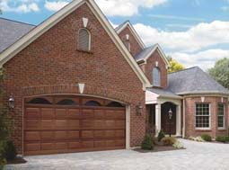 garage door color ideas for orangebrick house - Garage door painted to look like wood against red brick