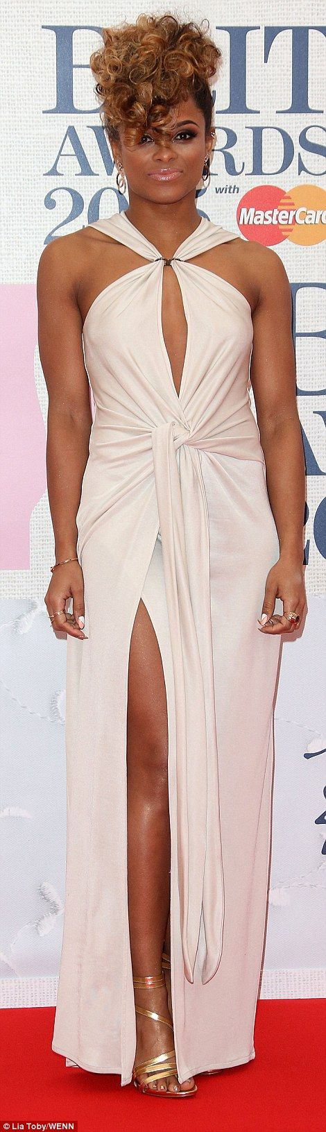 Fleur East's dress was elegant, but her OTT curly Elvis do let her look down as the singer piled her hair on top of her head