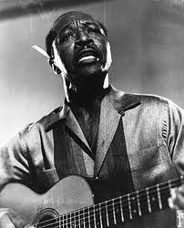 """Joshua Daniel White (February 11, 1914 – September 6, 1969), better known as Josh White, was a blues singer, guitarist, songwriter, actor, and civil rights activist. He also recorded under the names """"Pinewood Tom"""" and """"Tippy Barton"""" in the 1930s. White grew up in the Jim Crow South. During the 1920s and 1930s, he became a prominent race records artist, with a prolific output of recordings in genres including Piedmont blues, country blues, gospel, and social protest songs."""