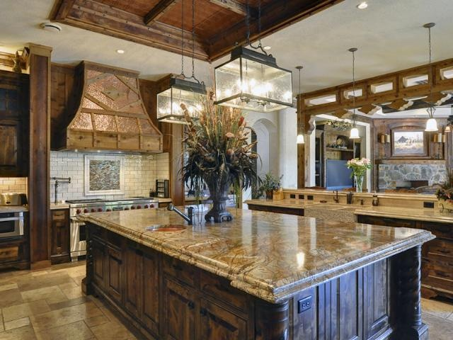 Love love love the lighting fixtures... and the giant island... and the copper oven hood... really, everything! (8901 Estribo Circle, Benbrook, Texas) #kitchen #luxury